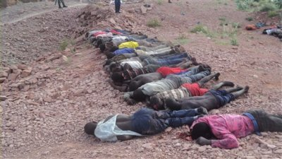 Bodies of Kenyans lie at a quarry in Mandera County, Kenya, Tuesday, Dec. 2, 2014. Kenya police said that at least 36 quarry workers were killed in an attack in northern Kenya  by suspected Islamic extremists from Somalia. Kenyan police chief David Kimaiyo confirmed the workers were killed early Tuesday in Mandera County. (AP Photo)