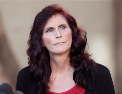 """In this Sept. 20, 2012, file photo, Cindy Lee Garcia, one of the actresses in """"Innocence of Muslims,"""" holds a news conference before a hearing at Los Angeles Superior Court in Los Angeles. Garcia is asking a judge to issue an injunction demanding the 14-minute trailer for """"Innocence of Muslims"""" be pulled from YouTube. A federal appeals court is reconsidering a decision to order YouTube to take down an anti-Muslim film that sparked violence in the Middle East and death threats to actors. (AP Photo/Jason Redmond, File)"""