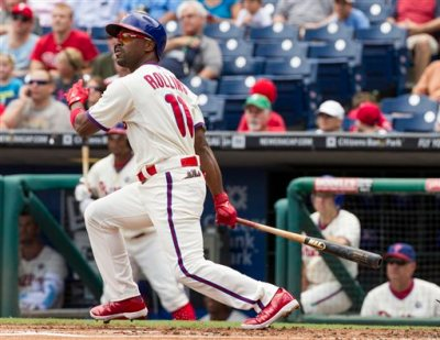 In this July 24, 2014, file photo, Philadelphia Phillies' Jimmy Rollins hits a double during the first inning of a baseball game against the San Francisco Giants in Philadelphia. The Phillies have finalized their trade of Jimmy Rollins, sending the All-Star shortstop and cash to the Los Angeles Dodgers for right-hander Zach Eflin and left-hander Tom Windle. The deal was agreed to last week at the winter meetings and announced Friday, Dec. 19, 2014,  a day after the Dodgers completed a trade that sent slugging outfielder Matt Kemp to San Diego. (AP Photo/Chris Szagola, File)