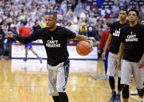 "Georgetown guard Jabril Trawick, left,  wears an ""I Can't Breathe"" t-shirt during warm ups before NCAA college basketball game against Kansas, Wednesday, Dec. 10, 2014, in Washington. (AP Photo/Nick Wass)"