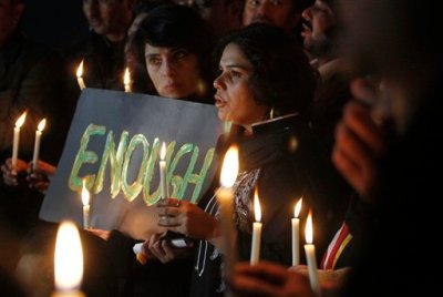 """Pakistani civil society members take part in a candle light vigil for the victims of a school attacked by the Taliban in Peshawar, Tuesday, Dec. 16, 2014 in Islamabad, Pakistan. British Prime Minister David Cameron issued a statement in response to the attack that killed more than 100, most of them children: """"The scale of what has happened in Pakistan simply defies belief. It is a dark, dark day for humanity when something on this scale happens with no justification."""" (AP Photo/Anjum Naveed)"""