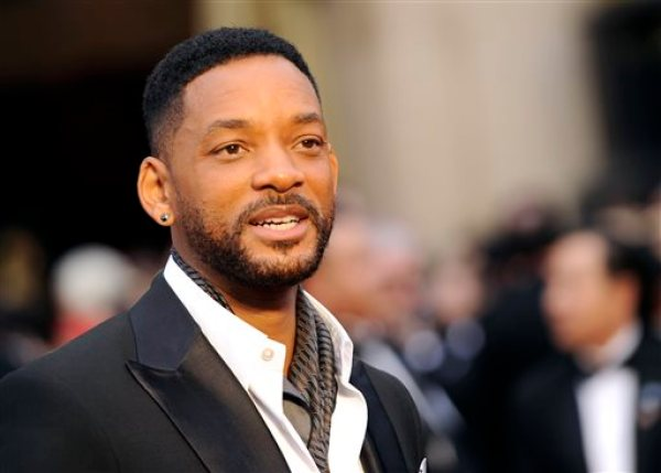 "In this March 2, 2014 file photo, Will Smith arrives at the Oscars at the Dolby Theatre in Los Angeles. Smith, Jared Leto and Tom Hardy are suiting up for DC Comics' supervillain team-up film ""Suicide Squad."" Warner Bros. confirmed the much anticipated casting of the film in an announcement Tuesday, Dec. 2, 2014.  (Photo by Chris Pizzello/Invision/AP, File)"