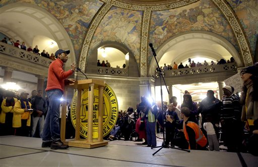 "NAACP President Cornell Brooks speaks in the Missouri Capitol rotunda after finishing a 7-day march Friday, Dec. 5, 2014, in Jefferson City, Mo. Scores of people, including Brooks, finished their 130-mile ""Journey for Justice"" march from  the St. Louis suburb of Ferguson to protest the police shooting of Michael Brown. (AP Photo/Jeff Roberson)"