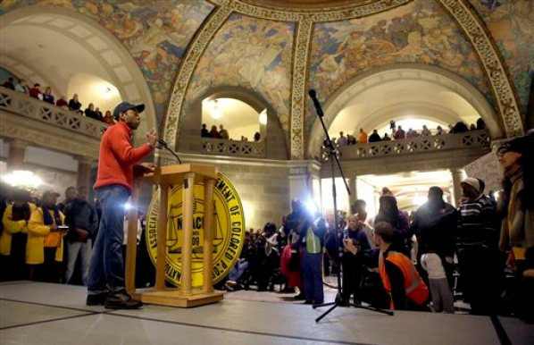 """NAACP President Cornell Brooks speaks in the Missouri Capitol rotunda after finishing a 7-day march Friday, Dec. 5, 2014, in Jefferson City, Mo. Scores of people, including Brooks, finished their 130-mile """"Journey for Justice"""" march from  the St. Louis suburb of Ferguson to protest the police shooting of Michael Brown. (AP Photo/Jeff Roberson)"""