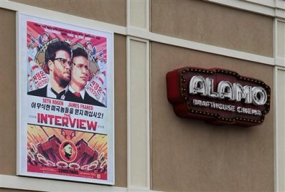 "A large poster advertising the movie The Interview hangs on the back wall of the Alamo Drafthouse Cinema Tuesday, Dec. 23, 2014, in Houston. Sony Pictures Entertainment announced Tuesday a limited theatrical release of ""The Interview"" beginning Thursday, putting back into the theaters the comedy that prompted an international incident with North Korea and outrage over its cancelled release. (AP Photo/Pat Sullivan)"