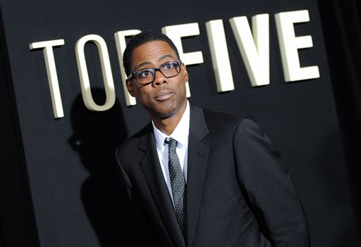 """FILE - In this Dec. 3, 2014 file photo, actor Chris Rock attends the premiere of """"Top Five"""" at the Ziegfeld Theatre in New York. While out promoting the film this week, Rock noted: """"My movie's very Korean-friendly. There are no jokes about North Korea in 'Top Five.' If you're Korean, go out and see 'Top Five.' You will enjoy it."""" (Photo by Evan Agostini/Invision/AP, File)"""