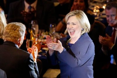 Former Secretary of State Hillary Rodham Clinton reacts as she and singer Tony Bennett, left, are introduced during the Robert F. Kennedy Ripple of Hope Award ceremony, Tuesday, Dec. 16, 2014 in New York. (AP Photo/Jason DeCrow)
