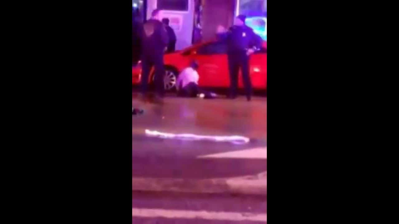 Baltimore Police Beat Woman for Videotaping them Beating Man in Custody