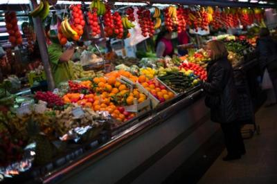 A woman buys fruit at a market in Barcelona, Spain. Mediterranean diets have long been touted as heart-healthy, but that's based on observational studies. Now, one of the longest and most scientific tests suggests this style of eating can cut the chance of suffering heart-related problems, especially strokes, in older people at high risk of them. (Emilio Morenatti/AP Photo)