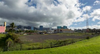 In this Dec. 24, 2013 file photo, one possible location in the Kakaako district of Honolulu to be considered for the Barack Obama Presidential Library. Four universities in Chicago, New York and Honolulu are trying to outdo one another as they compete to host Barack Obama's future presidential library. Each is offering primo real estate, major financial backing and a grand vision for what the library should look like, and next week, a handful of Obama's oldest friends will start picking the winner. A look at what each school is proposing. (AP Photo/Eugene Tanner)