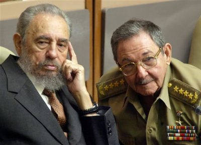 In this July 31, 2004 file photo, Cuba's President Fidel Castro, left, and his brother, Minister of Defense Raul Castro, attend a Parliament session in Havana, Cuba. The 1991 collapse of the Soviet Union devastated the Cuban economy, but the country limped along, first under Fidel and then, after he fell ill in 2006, under his brother Raul, head of the Cuban military. On Wednesday, Dec. 17, 2014, the U.S. and Cuba agreed to re-establish diplomatic relations and open economic and travel ties, marking a historic shift in U.S. policy toward the communist island after a half-century of enmity dating back to the Cold War. (AP Photo/Cristobal Herrera, File)