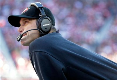 San Francisco 49ers head coach Jim Harbaugh watches from the sideline during the first quarter of an NFL football game against the Arizona Cardinals in Santa Clara, Calif., Sunday, Dec. 28, 2014. (AP Photo/Marcio Jose Sanchez)