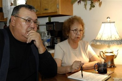 In this Nov. 10, 2009 file photo, George and Marilyn Keepseagle talk about the lawsuit, at their kitchen table, in Fort Yates, N.D. American Indian groups are fighting a plan to create a charitable foundation with almost $400 million in federal dollars left over fro a 2010 government discrimination settlement. A federal judge will review the matter Tuesday. (AP Photo/Will Kincaid)