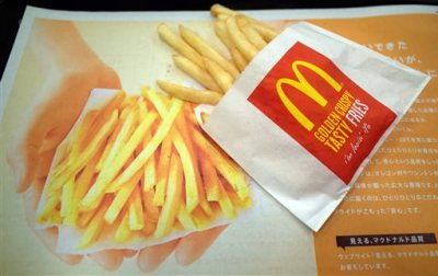 A small fries is seen at a McDonald's restaurant in Tokyo, Wednesday, Dec. 17, 2014.  McDonald's in Japan has begun limiting the serving size of fries as stocks of spuds run short due to labor disruptions on the U.S. West Coast. (AP Photo/Eugene Hoshiko)