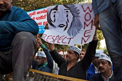 Supporters of Aam Aadmi (Common Man) Party (AAP) hold placards during a protest after a woman was allegedly raped by a taxi driver in New Delhi, India, Monday, Dec. 8, 2014. The Indian capital on Monday banned taxi-booking service Uber after a woman accused one of its drivers of raping her.(AP Photo/Tsering Topgyal)