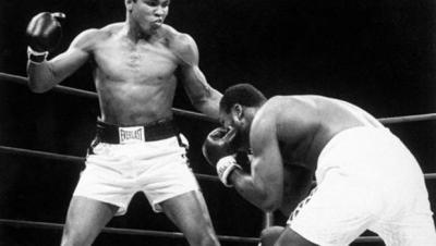 Muhammad Ali, left, throws a punch at Joe Frazier during their Jan. 28, 1974 bout at Madison Square Garden in New York.(AP Photo/File)
