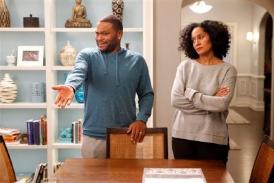 """In this image released by ABS, Anthony Anderson, left, and Tracee Ellis Ross appear in a scene from """"Black-ish."""" The series was created by Kenya Barris, who was motivated to write the comedy about an African-American family's efforts to honor its heritage in part by the unreality of what he grew up watching on television. (AP Photo/ABC, Kelsey McNeal)"""