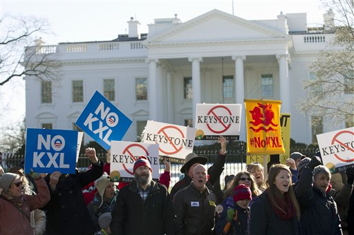 In this Jan. 10, 2015 file photo, demonstrators stand in front of the White House in Washington, during a rally in support of President Barack Obama's pledge to veto any legislation approving the Keystone XL pipeline. Supporters of the Keystone XL pipeline say the privately-funded, $8 billion project is a critically needed piece of infrastructure that will create thousands of jobs and make the U.S. dependent on oil from friends, rather than foes. Critics claim it will be disastrous for the pollution blamed for global warming and put communities along its 1,179-mile route at risk for an environmentally-damaging spill, all for oil and products that will be exported anyway. (AP Photo/Jose Luis Magana, File)