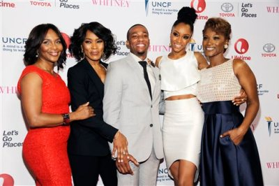 """Actress Angela Bassett, second from left, making her directorial debut with the Lifetime film """"Whitney,"""" poses with cast members, left to right, Suzzanne Douglas, Arlen Escarpeta, Yaya DaCosta and Yolonda Ross at the premiere of the film at the Paley Center for Media on Tuesday, Jan. 6, 2015, in Beverly Hills, Calif. (Photo by Chris Pizzello/Invision/AP)"""
