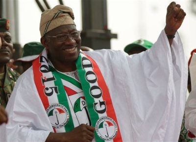 Nigeria President Goodluck Jonathan gestures, during an election campaign rally, at Tafawa Balewa Square in Lagos, Nigeria, Thursday, Jan. 8, 2015. The president launches his bid for re-election at a time when Africa's biggest oil producer is more divided than ever, amid a growing Islamic uprising in the northeast and slumping oil prices and the naira currency biting into people's pockets. (AP Photo/Sunday Alamba)