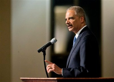In this Dec. 1, 2014 file photo, Attorney General Eric Holder speaks at Ebenezer Baptist Church in Atlanta.  The Justice Department on Wednesday announced revised guidelines for obtaining records from the news media during leak investigations, removing language that news organizations said was ambiguous and requiring additional consultation before a journalist can be subpoenaed. (AP Photo/David Goldman, File)
