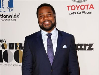 """In this Nov. 19, 2014 file photo, actor Malcolm-Jamal Warner attends the 2014 Ebony Power 100 Gala at The Avalon Hollywood in Los Angeles. Warner says it's difficult to see Bill Cosby face allegations of sexual assault. Warner, who played Cosby's son Theo in the hit 1980s sitcom """"The Cosby Show,"""" told Billboard magazine that the comedian has been an important mentor and friend to him. (Photo by Brian Dowling/Invision/AP, File)"""