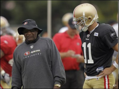 Former San Francisco 49ers offensive coordinator Jimmy Raye is seen in this Aug. 6, 2010 file photo with quarterback Alex Smith. (AP Photo)