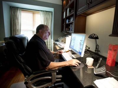 In this Wednesday, Oct. 9, 2013 photo, graphic designer Tom Sadowski, 65, who delayed his retirement, works from home in Sterling, Va. (AP Photo/Manuel Balce Ceneta)