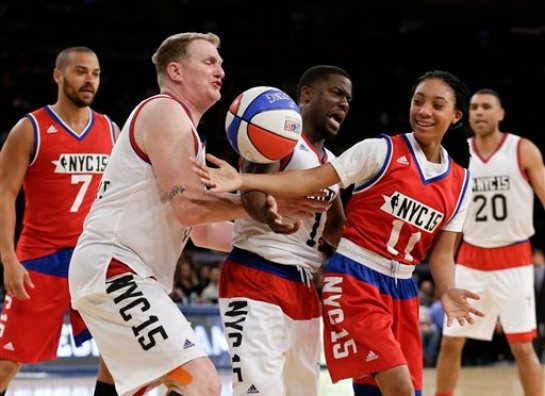 Kevin Hart, center, and Michael Rapaport, left, defend Mo'ne Davis, right, during the first half of the NBA All-Star celebrity basketball game Friday, Feb. 13, 2015, in New York. (AP Photo/Frank Franklin II)