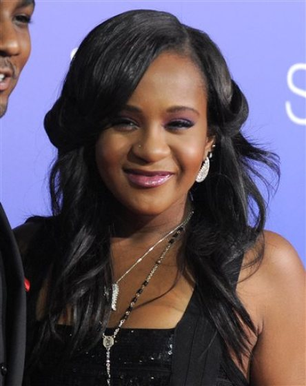 "In this Aug. 16, 2012, file photo, Bobbi Kristina Brown attends the Los Angeles premiere of ""Sparkle"" at Grauman's Chinese Theatre in Los Angeles. Messages of support were being offered Monday, Feb. 2, 2015, as people awaited word on Brown, who authorities say was found face down and unresponsive in a bathtub over the weekend in a suburban Atlanta home. (Photo by Jordan Strauss/Invision/AP, File)"
