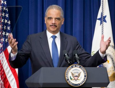 In this Feb. 11, 2015 file photo, Attorney General Eric Holder speaks to law enforcement officers and guests in the Old Executive Office Building on the White House Complex in Washington. The share of federal drug offenders who received harsh mandatory minimum sentences has plunged in the past year, according to figures obtained by The Associated Press that Holder plans to cite Tuesday in arguing for the success of his criminal justice policies. Experts credit Holder for helping raise sentencing policy as a public issue, but they also say it's hard to gauge how much of the impact is directly attributable to his actions. (AP Photo/Pablo Martinez Monsivais, File)