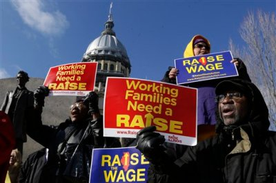 In this Nov. 20, 2014, file photo, supporters of legislation that will raise the minimum wage in Illinois rally outside the Illinois State Capitol in Springfield Ill. Most Americans support increasing the minimum wage, as well as requiring employers to provide paid sick leave and parental leave, according to a new Associated Press-GfK poll. Proposals to increase the federal minimum wage, as well as to require employers to give paid leave to their employees, find few objections among Americans as a whole. (AP Photo/Seth Perlman, File)