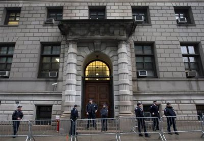 In this Dec. 3, 2014, photo, security personnel stand outside Richmond County Supreme Court after a grand jury's decision not to indict a New York police officer involved in the police-chokehold death of Eric Garner, in the Staten Island borough of New York. The New York Civil Liberties Union and other petitioners have gone to court on Staten Island to demand that Judge William Garnett open the record in the Eric Garner case — a position opposed by Richmond Count District Attorney Daniel Donovan. Garnett is set to hear arguments at a hearing on Thursday morning Feb. 5, 2015. (AP Photo/John Minchillo, File)
