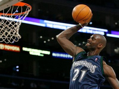 In this March 18, 2007, file photo, Minnesota Timberwolves' Kevin Garnett (21) goes to the hoop in the second quarter of their NBA basketball game against the Los Angeles Lakers in Los Angeles. Garnett is coming back to the place it all began. A person with knowledge of the deal says the Minnesota Timberwolves are sending forward Thaddeus Young to the Brooklyn Nets for Garnett. The person spoke Thursday, Feb. 19, 2015,  on condition of anonymity because the deal had not been officially announced. (AP Photo/Gus Ruelas, File)