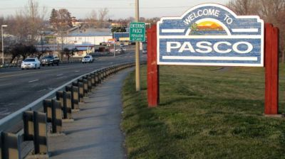 In this Feb. 18, 2015 photo, a sign welcomes motorists to Pasco, Wash. For the past week, protesters have gathered daily in front of the City Hall in this agricultural community to protest the fatal shooting of Antonio Zambrano-Montes, an unarmed man who was running away from police at a crowded intersection. (Nicholas K. Geranios/AP Photo)