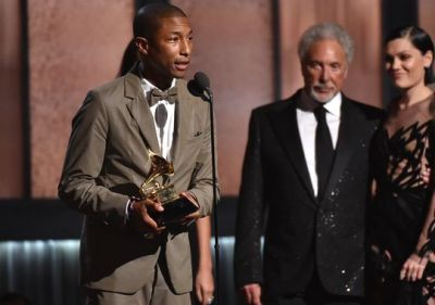 """Pharrell Williams accepts the award for best pop solo performance for """"Happy"""" at the Grammys. (John Shearer/Invision/AP)"""
