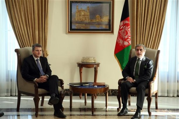 """In this Thursday, Jan. 15, 2015 photo, Afghanistan's chief executive Abdullah Abdullah, right, speaks during a meeting with U.S. Special Representative for Afghanistan and Pakistan, Daniel F. Feld, at Sapidar Palace, in Kabul, Afghanistan. Abdullah said on Monday that his government will begin peace talks with the Taliban insurgents, who have been waging war in the country for more than a decade, """"in the near future."""" (AP Photo/Massoud Hossaini)"""