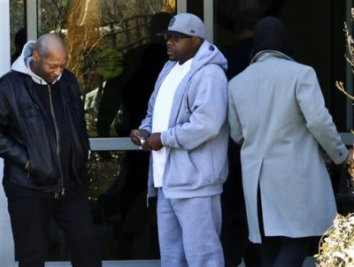 Entertainer Bobby Brown, center, stands outside of Emory Hospital in Atlanta where his daughter Bobbi Kristina Brown is being treated, Thursday, Feb. 5, 2015. Bobbi Kristina Brown, the only child of Bobby and the late Whitney Houston, has been hospitalized since Jan. 31 after being found unresponsive in a bathtub at a suburban Atlanta home. (AP Photo/Ron Harris)