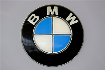 This Feb. 14, 2013 file photo shows the BMW logo at the Pittsburgh Auto Show, in Pittsburgh. BMW placed tenth on Consumer Reports magazine's list of top auto brands, released Tuesday, Feb. 24, 2015. (AP Photo/Gene J. Puskar, File)