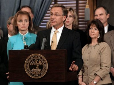 In this Jan. 10, 2012 file photo, Rep. Sheila Butt, R-Columbia, lower right, listens as Gov. Bill Haslam, center, talks about his legislative agenda on the opening day of the second session of the 107th General Assembly in Nashville, Tenn. The Tennessee Legislative Black Caucus has said Butt should apologize for a Facebook post they say is racist. (AP Photo/Mark Humphrey, File)