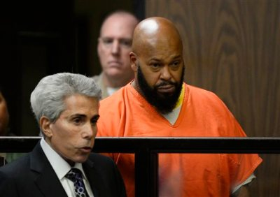 "Marion ""Suge"" Knight, right, is joined by his attorney David Kenner, left, during his arraignment, Tuesday, Feb. 3, 2015 in Compton, Calif.  Knight, 49,  pleaded not guilty on to murder, attempted murder and other charges filed after he struck two men with his truck last week. (AP Photo/Paul Buck, Pool)"