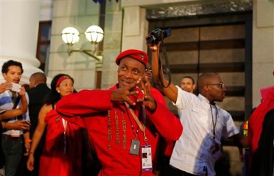 A member of the South African Economic Freedom Fighters, EFF, leaves Parliament after they disrupted the official opening session in Cape Town, South Africa, Thursday, Feb. 12, 2015. South African President Jacob Zuma will deliver the State of the Nation Address after the opening session of the South African Parliament.  (AP Photo/Schalk van Zuydam, Pool)