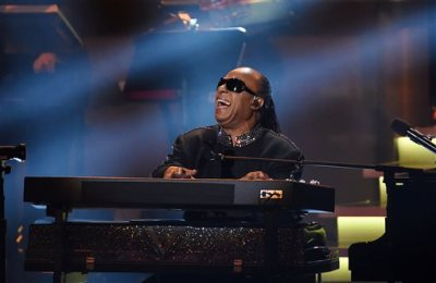 """Stevie Wonder performs during the finale of """"Stevie Wonder: Songs in the Key of Life - An All-Star Grammy Salute,"""" at the Nokia Theatre L.A. Live on Tuesday, Feb. 10, 2015, in Los Angeles. (Photo by Chris Pizzello/Invision/AP)"""