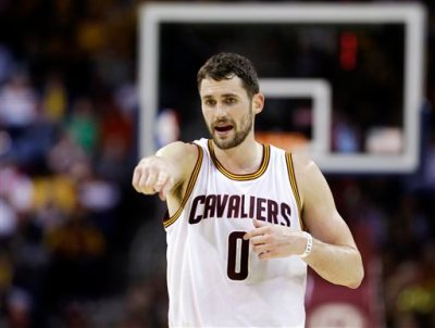 FILE - In this Jan. 28, 2015, file photo, Cleveland Cavaliers' Kevin Love talks with a teammate during an NBA basketball game against the Portland Trail Blazers in Cleveland. The surging Cleveland Cavaliers visit Minnesota on Saturday for the first time since they acquired Kevin Love from the Timberwolves in the summer blockbuster deal.  (AP Photo/Tony Dejak, File)