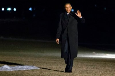 President Barack Obama waves as walks across the South Lawn of the White House after speaking about immigration in Miami, on his return in Washington, Wednesday, Feb. 25, 2015, (AP Photo/Jacquelyn Martin)