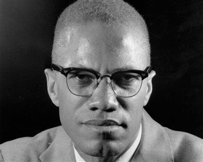 "In this March 5, 1964, file photo, Muslim leader Malcolm X poses during an interview in New York. One of the last major digital holdouts, ""The Autobiography of Malcolm X,"" should soon be available as an e-book, the attorney for the late activist's estate told The Associated Press, Friday, Feb. 20, 2015. (AP Photo/Eddie Adams, File)"