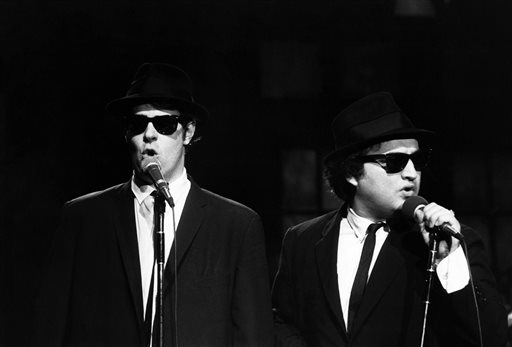 """This Nov. 18, 1978 photo released by NBC shows Dan Aykroyd as Elwood Blues, left, and John Belushi as Jake Blues, performing as the Blues Brothers on """"Saturday Night Live,"""" in New York. The long-running sketch comedy series will celebrate their 40th anniversary with a 3-hour special airing Sunday at 8 p.m. EST on NBC. (AP Photo/NBC, Al Levine)"""