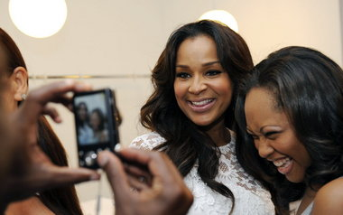 "LisaRaye McCoy greets a fan in Atlanta in May to celebrate the premiere of VH1's ""Single Ladies.'' The show is taped in Atlanta. McCoy plays a character named, Keisha. (Special/AP Images for VH1)"