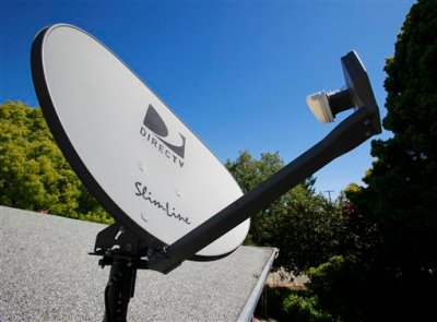 In this May 6, 2010 file photo, a DirecTV satellite dish is attached to a roof at a home in Palo Alto, Calif. The government is taking the nation's biggest satellite TV provider to court, accusing DirecTV of misleading millions of consumers about the cost of its programming. The Federal Trade Commission said Wednesday that its complaint charges DirecTV Inc. with deceptively advertising a discounted 12-month programming package. Consumers weren't clearly told that the package requires a two-year contract, the commission said. (AP Photo/Paul Sakuma, File)