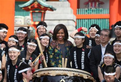 US first lady Michelle Obama poses for a photo with the Akutagawa High School Taiko Club during her visit to Fushimi Inari Shinto Shrine in Kyoto, in western Japan, Friday, March 20, 2015. Taiko are a a broad range of Japanese percussion instruments, and have a mythological origin in Japanese folklore. (AP Photo/Koji Sasahara)